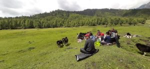 Herders having their farewell feast before commencing migration